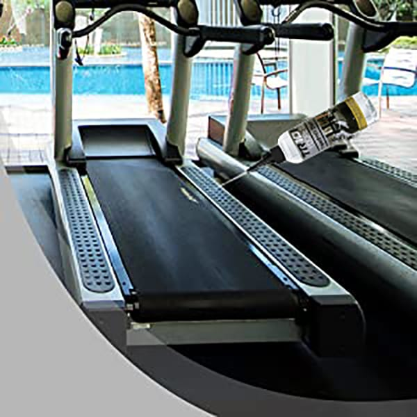 250ml Treadmill Silicone Oil being applied to a Treadmill Belt