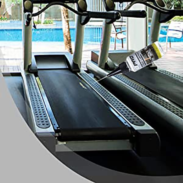 50ml Treadmill Silicone Oil being applied to a Treadmill Belt