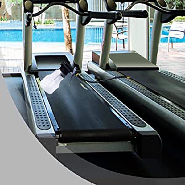 5ltr Treadmill Silicone Oil being applied to a Treadmill Belt